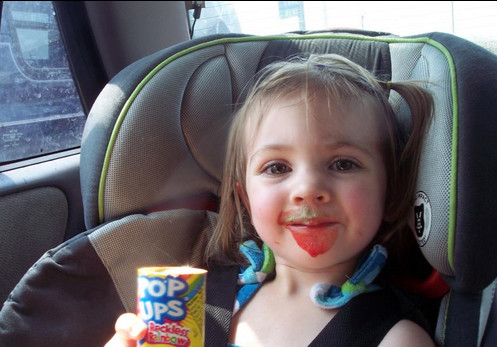 Lia eating a push pop on the way to St. George